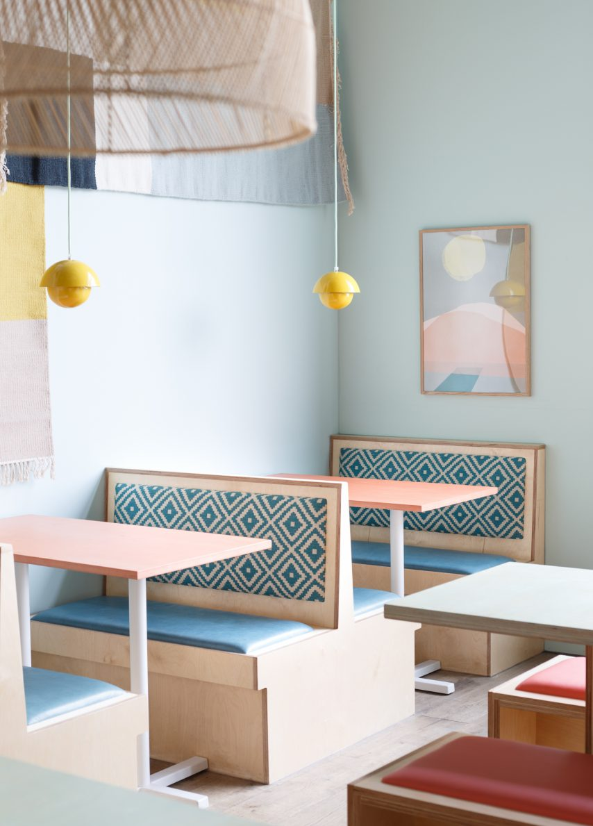 Shola Kitchen White City, London by KAI Interiors booth seating restaurant london